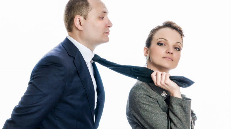 Woman in control of a man